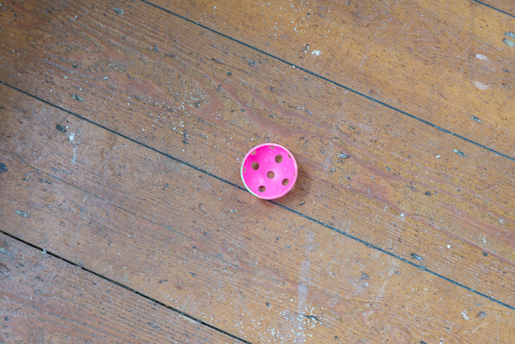 Pink perforated ping-pong ball
