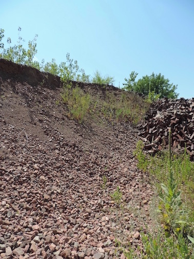 Acme/Ochs Brick Plant: Mountain of crushed brick for use as temper material.