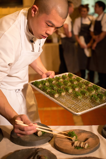 Chef Corey Lee of San Francisco restaurant,  Benu  plating   eggplant, shiitake, and sesame leaf during Steinbeisser's experimental gastronomy event at Montalvo Arts Center, 2017.