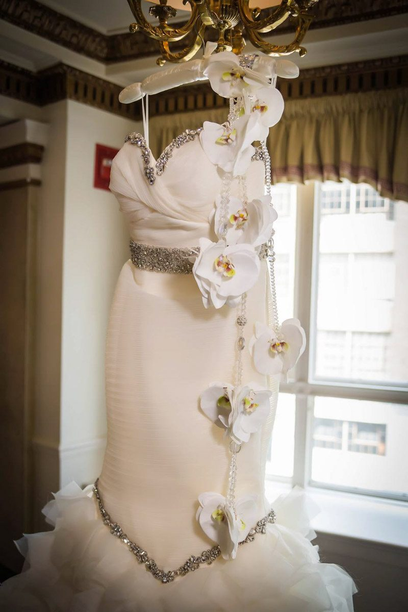 Silver-Beaded-White-Wedding-Dress-with-White-Orchids.jpg
