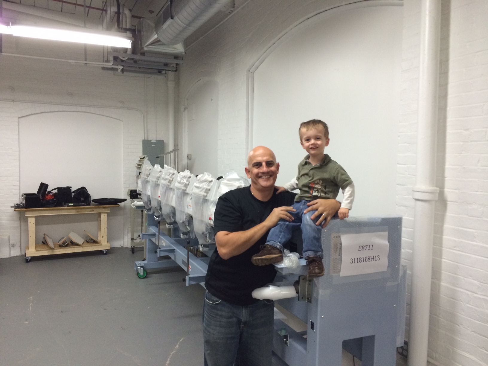 Dale Allen, Founder and CEO of Xpression Prints, Inc. with his son