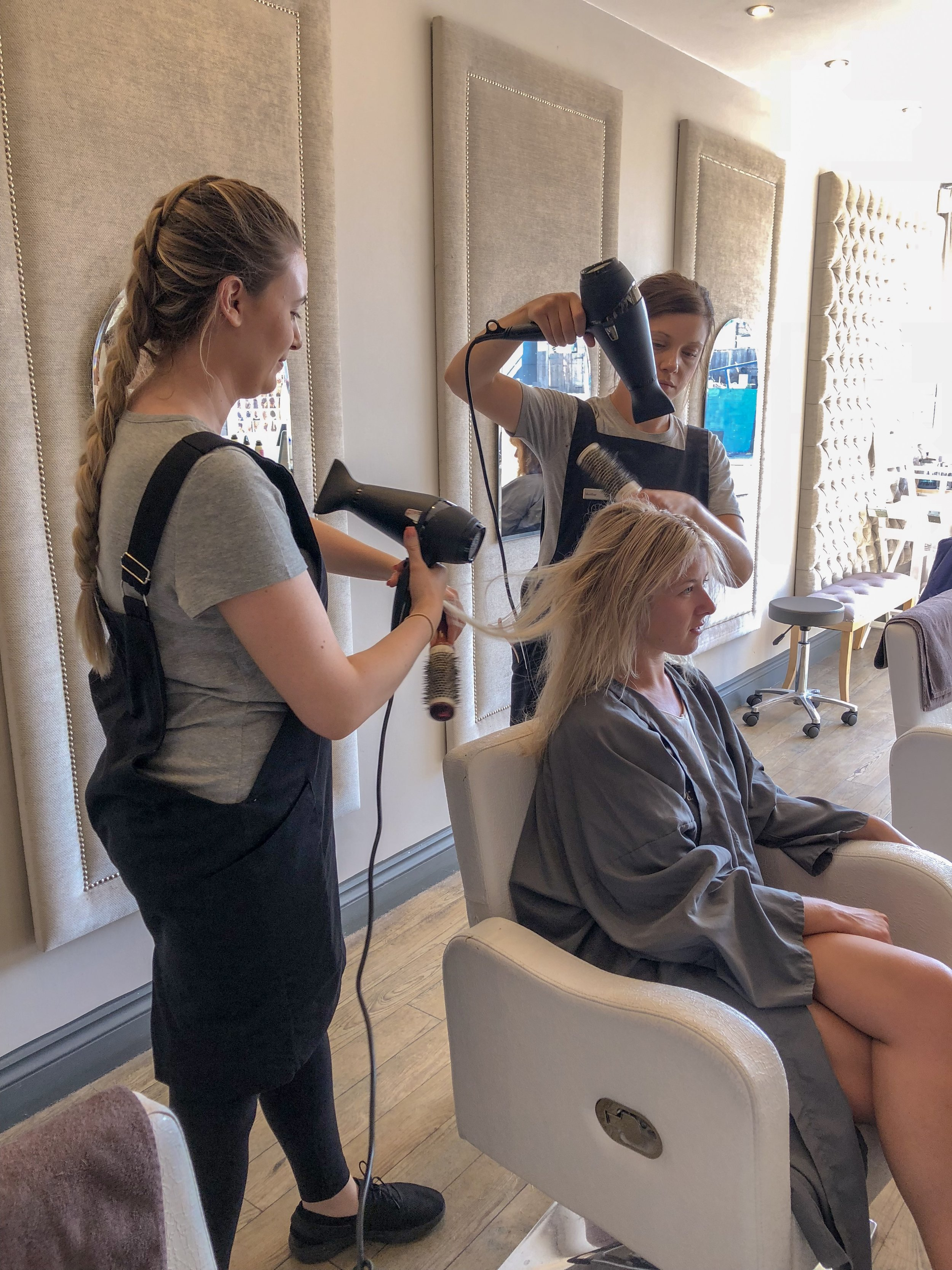 That's Mel on the left (who will be doing your hair) with our fully-trained stylist on the right, Lacey. Your hair will never be worked on without a trained stylist present.