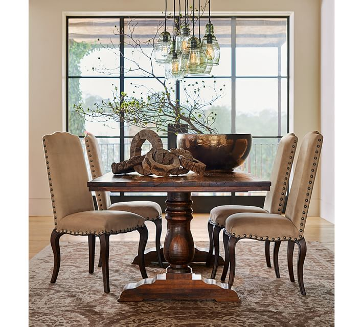 POTTERY BARN LOWRY RECLAIMED WOOD FIXED DINING TABLE     This Pottery Barn table has a rich stain and perfect for a more formal room! We love the beautiful markings on it! Just look at that stain!