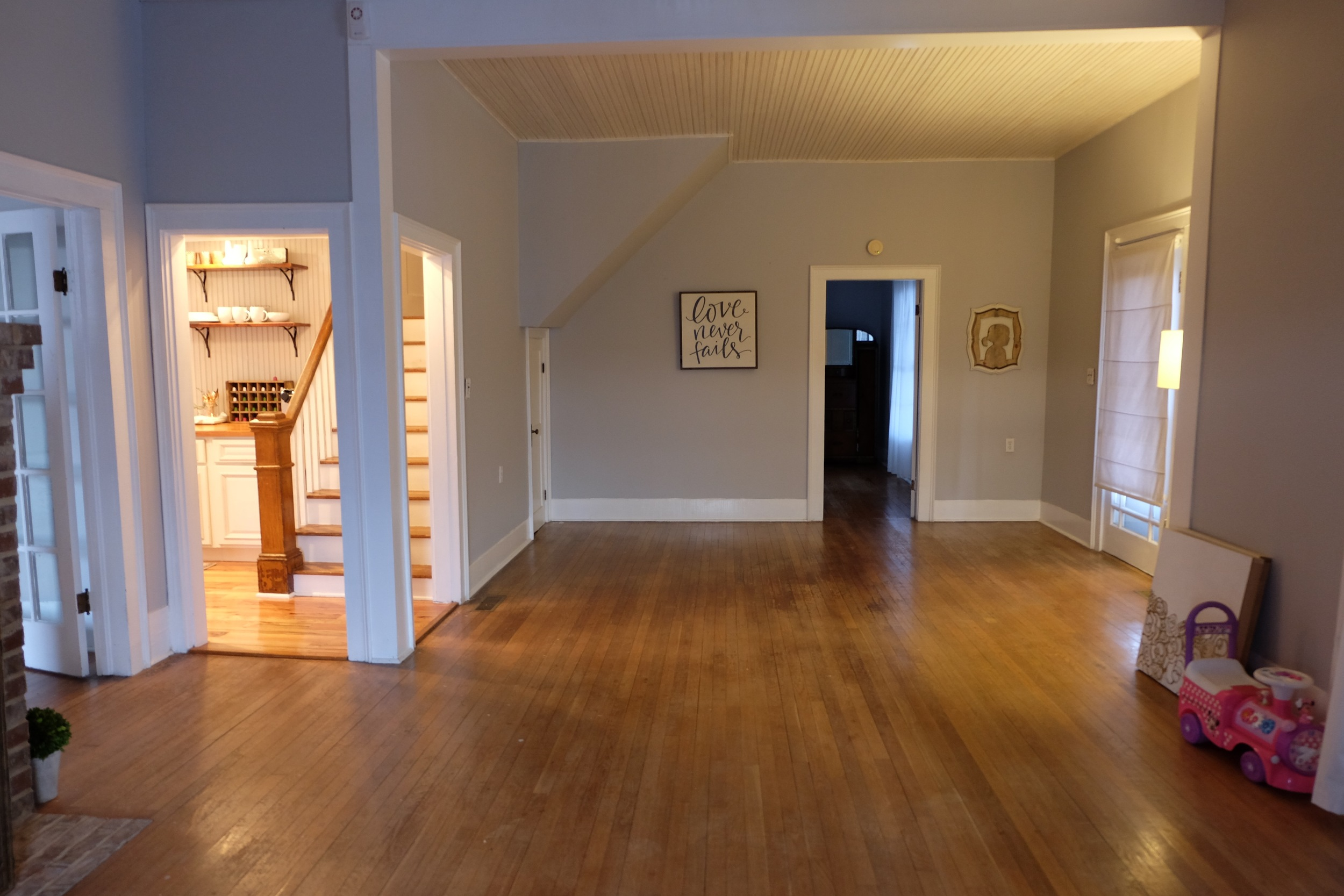 This is all the same room. It's a large living room and walkway into the kitchen & dining room. The door opened straight ahead goes to my bedroom.