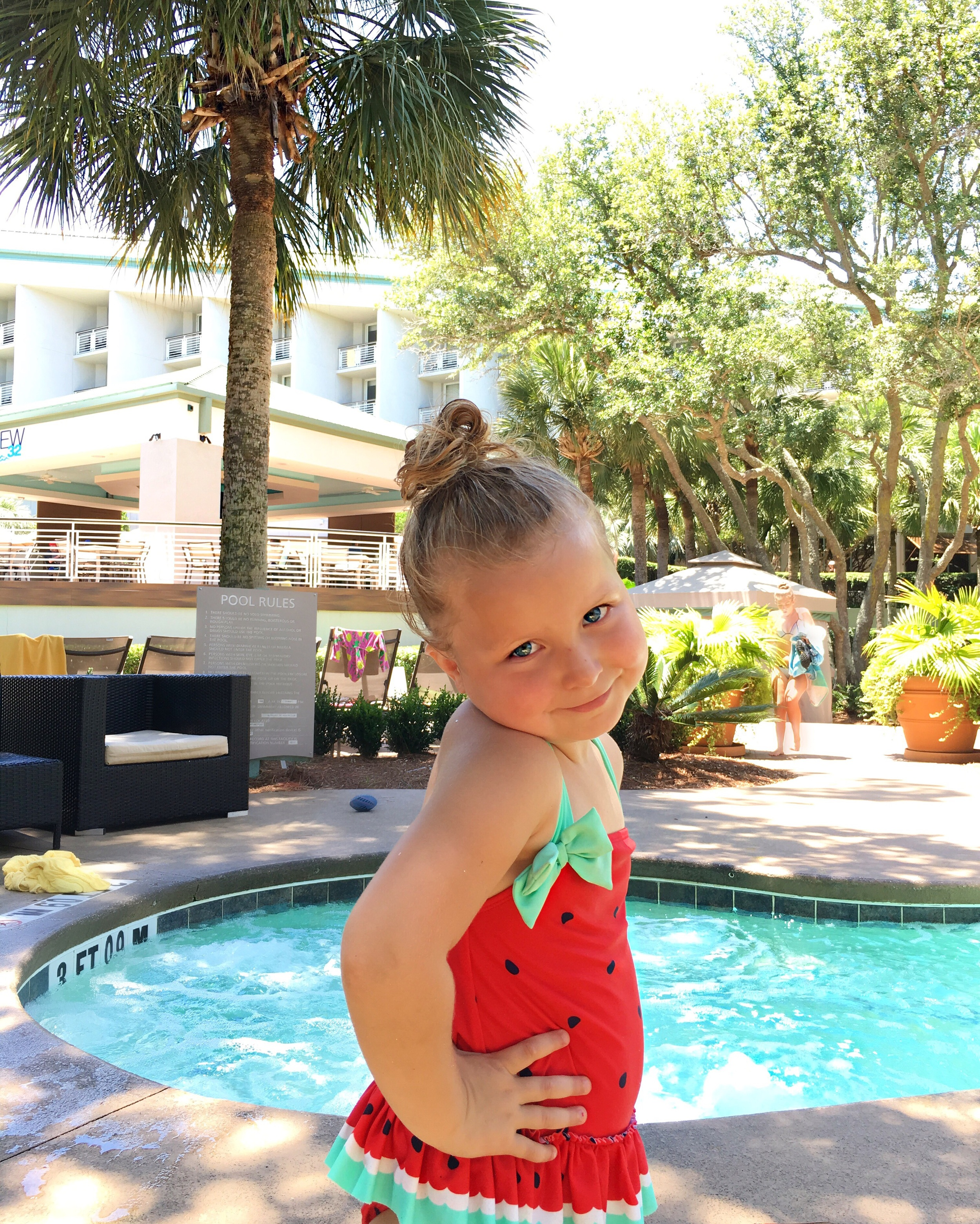 She took full advantage of all the pools and hot tub! Look at that smile!