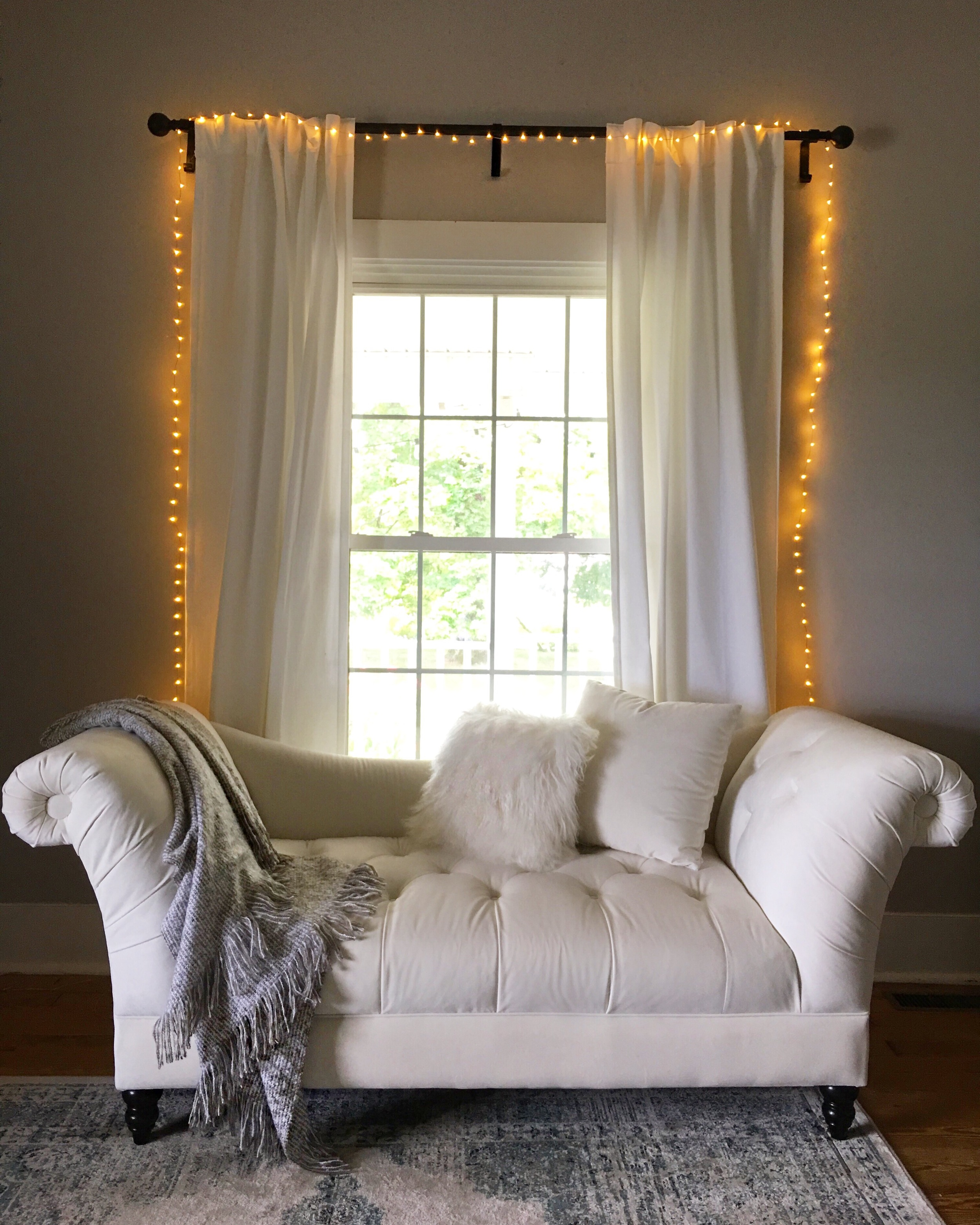 Settee:  Jonathan Louis Furniture   String Lights:  Restoration Hardware    Accent Pillow: Crate & Barrel   Curtains: West Elm