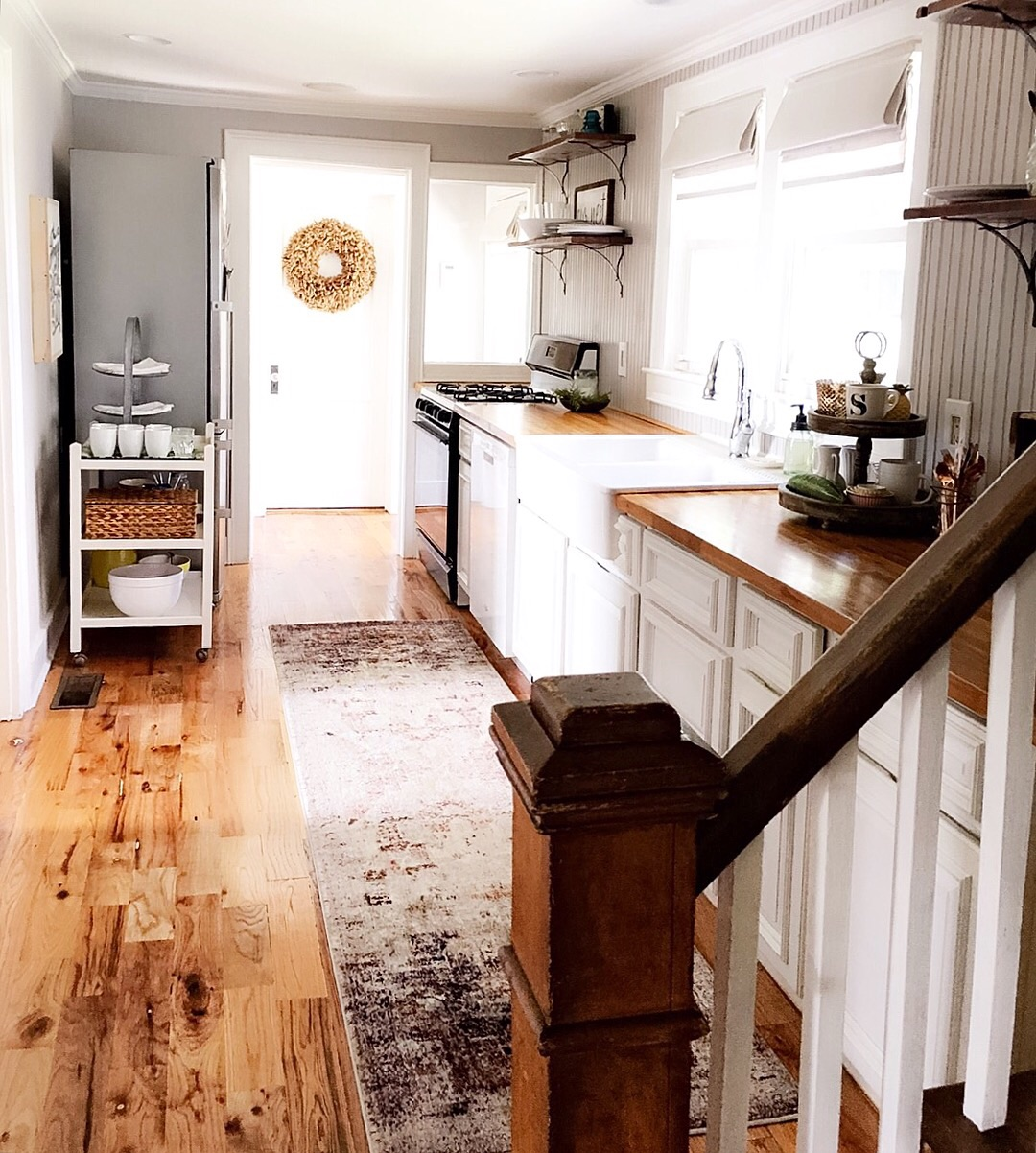 Floor: Pinewood  Countertops: Butcher Block, came with the house when I bought it   Two Tiered Tray:  Textured Home   3 Tiered Stand on vintage bar cart:  Crate & Barrel   Wreath: Rust & Honey