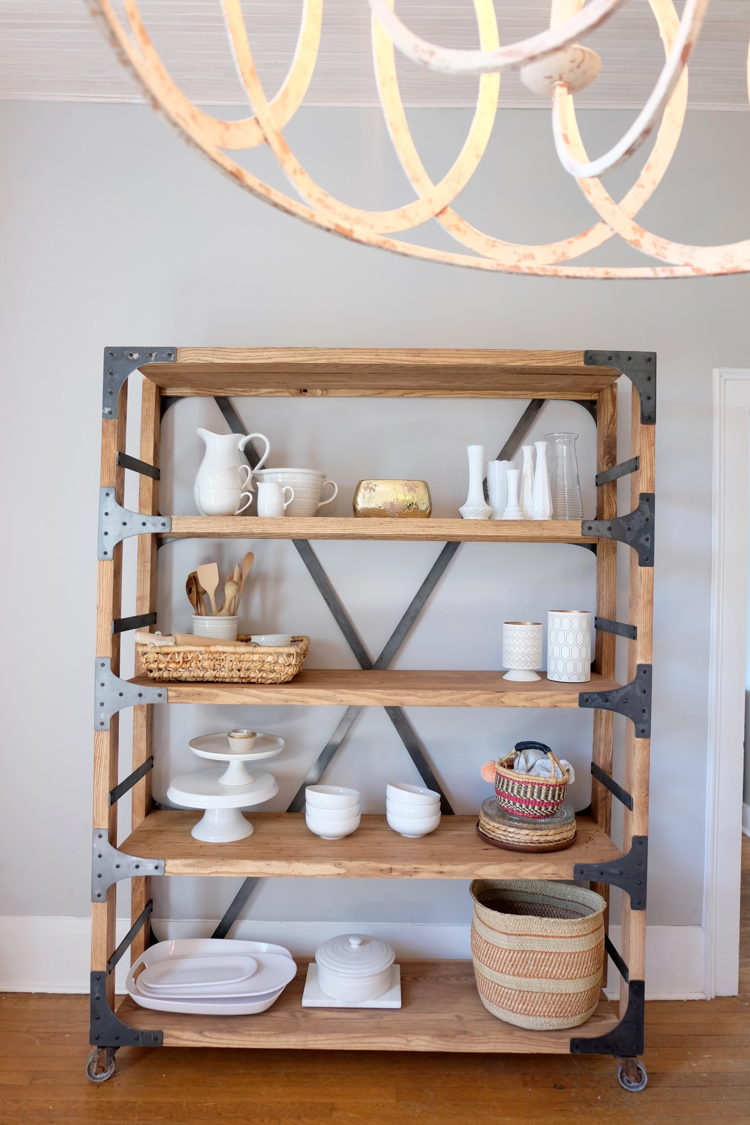 I love how it adapts to any space. You can style it any way you want to fit your home. This is my go to shelf so I use these pieces a lot. It works out great for storage and beautifully built!!