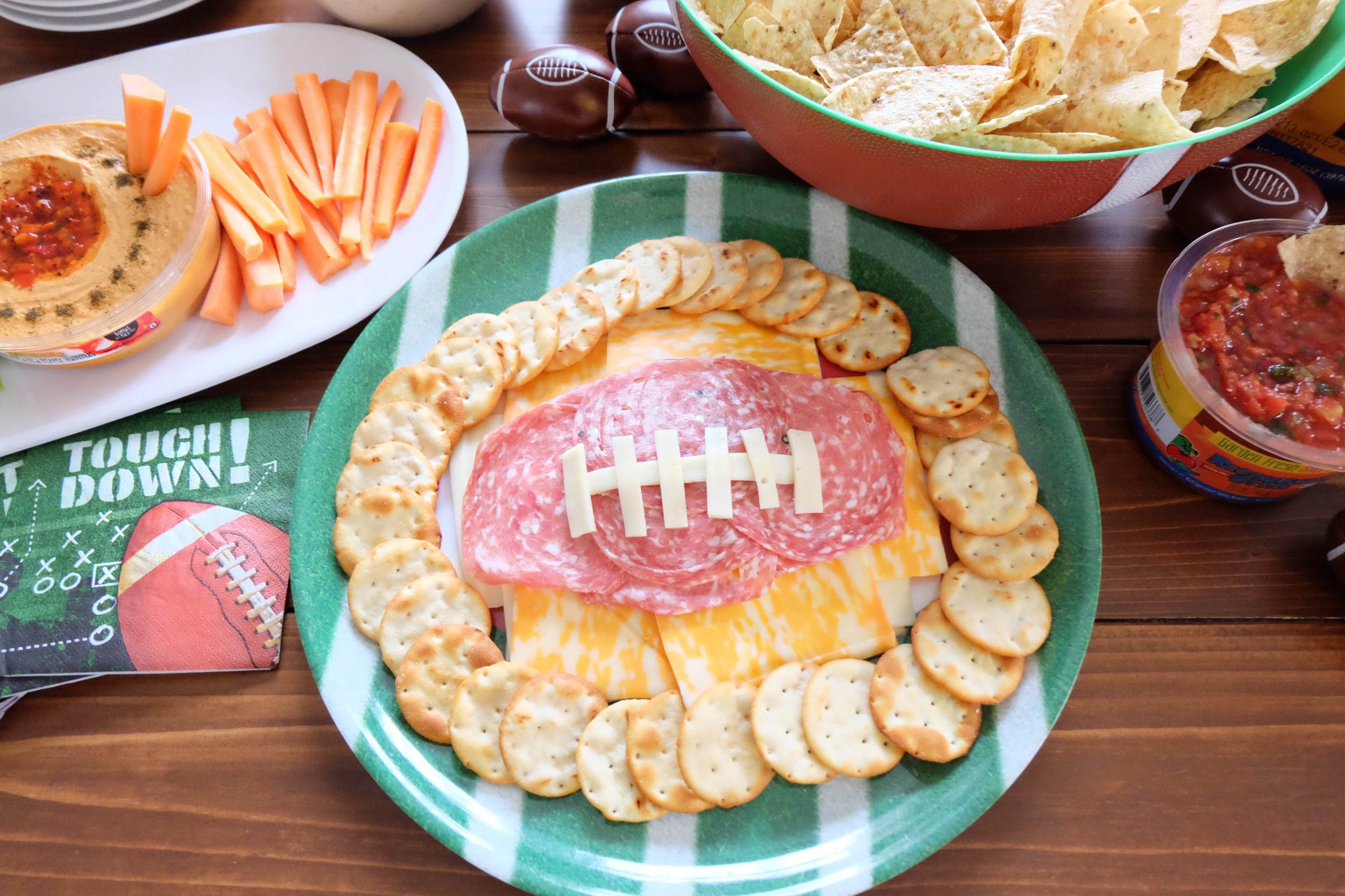 You guys, we are SO ready for the Big Game this weekend, mostly because of the FOOD and halftime show!   Here is the ultimate nacho table with a lot of trimmings! We used a lot of   Garden Fresh Gourmet   Foods.   Garden Fresh Gourmet Chips, salsas, hummus dips and paired it with our favorite cheeses, meats and veggies! One of the many reasons I love Garden Gourmet is because they are natural,  Non GMO and super fresh. We added our favorite cheese dip and taco meat with the spread!