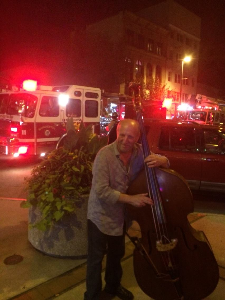 BG outside club in Manchester, NH after smoke detectors went off during the bass solo. LOL