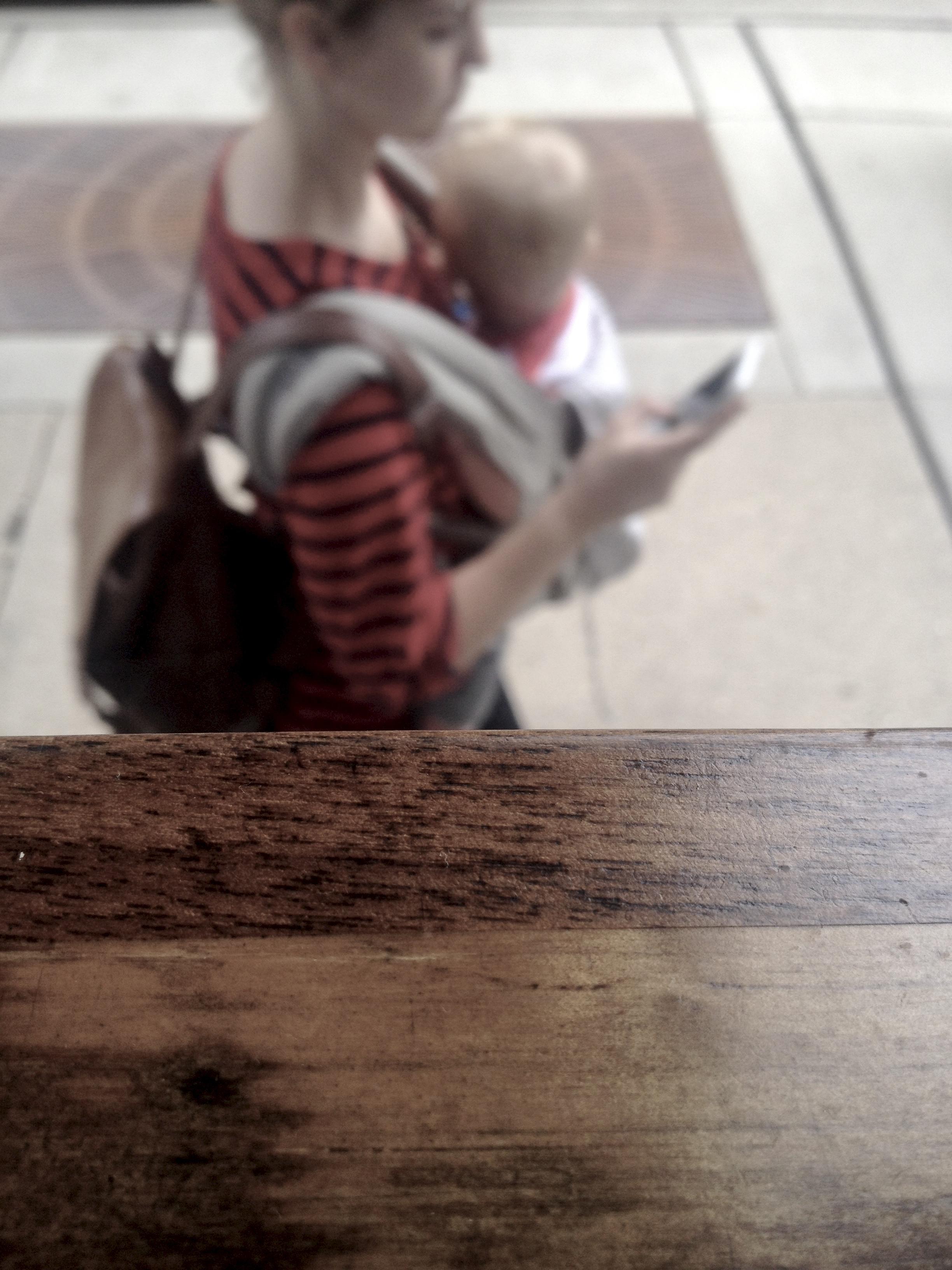 Baby Wearer No. 1. A Coffee Shop Window. Madison, Wisconsin. October 2016. © William D. Walker