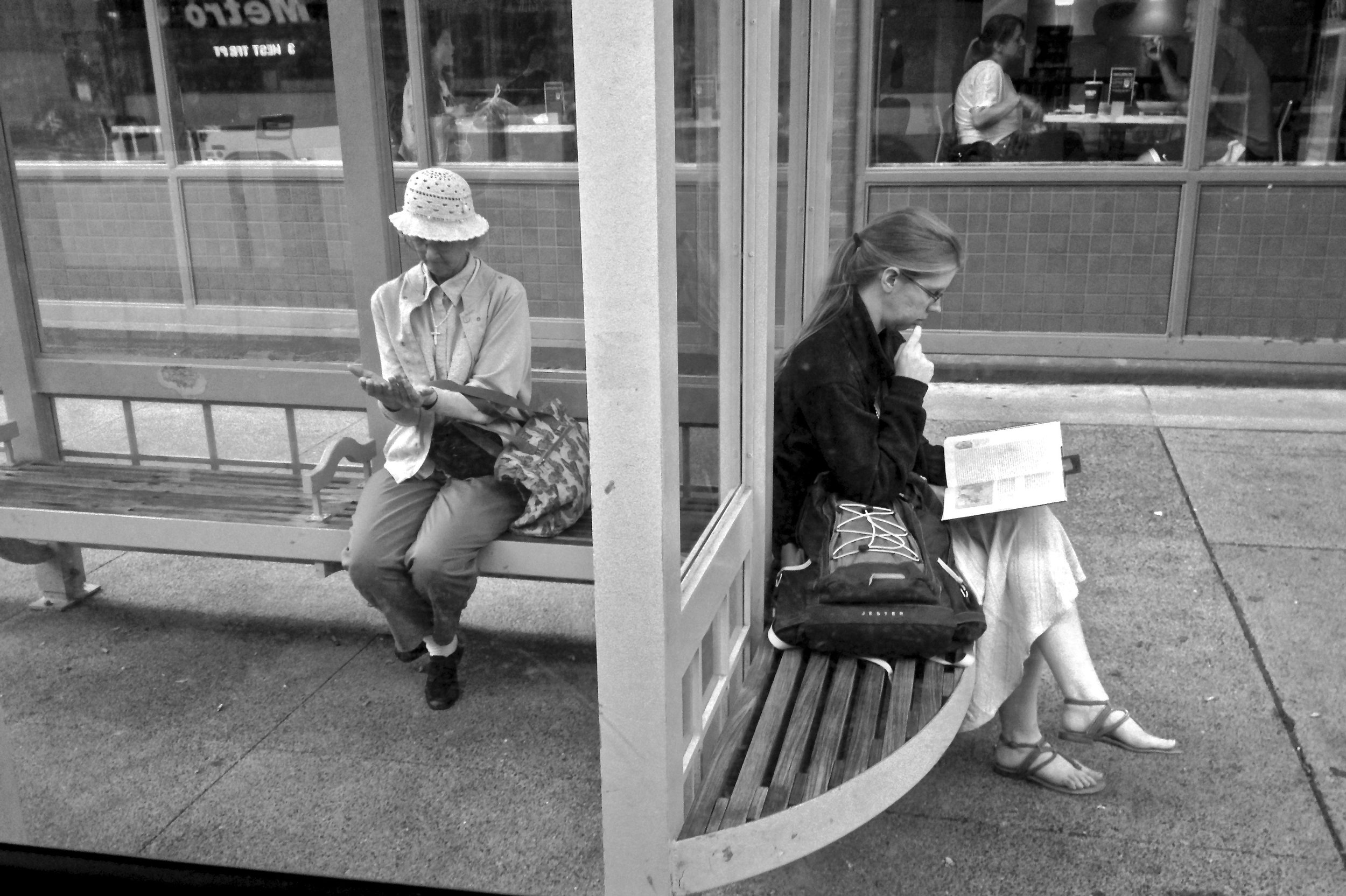 Women at a Bus Stop.  State Street. Madison, Wisconsin.  June 2015. © William D. Walker