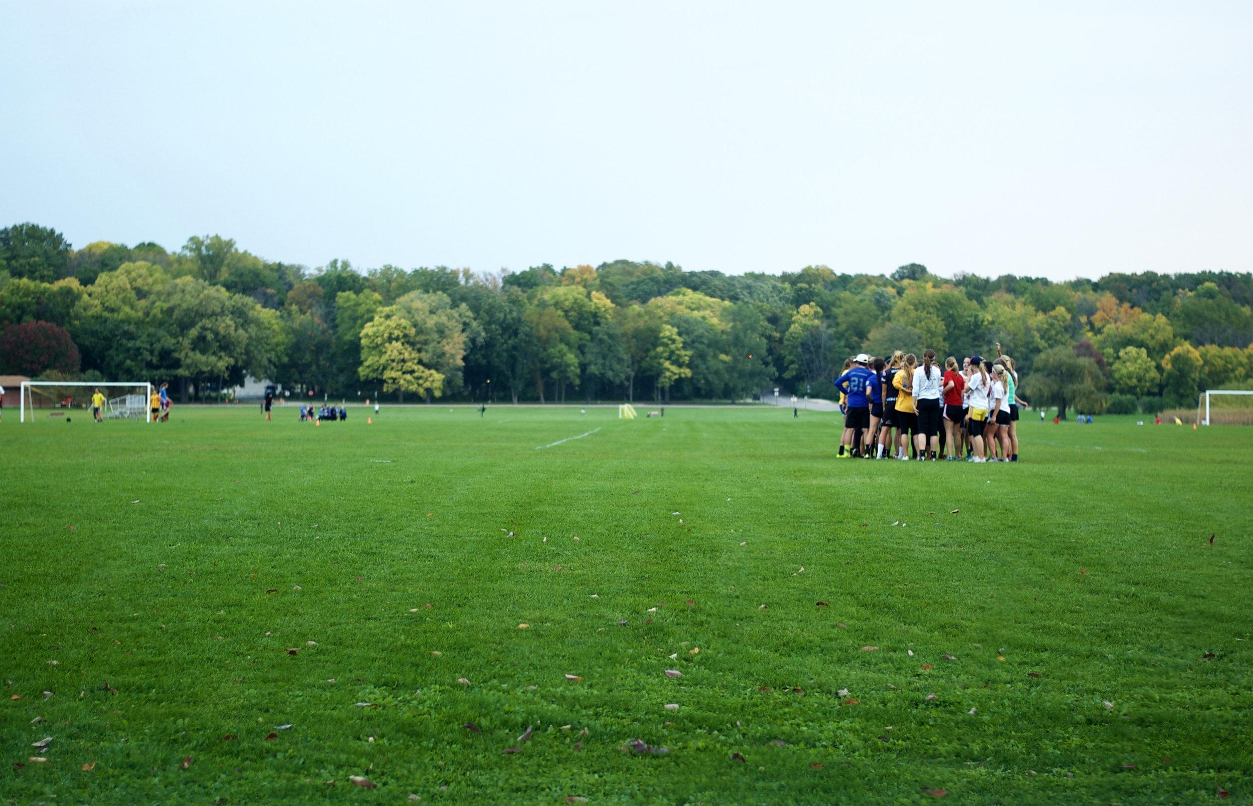 Huddle. University Bay Fields. Madison, Wisconsin. October 2014. © William D. Walker