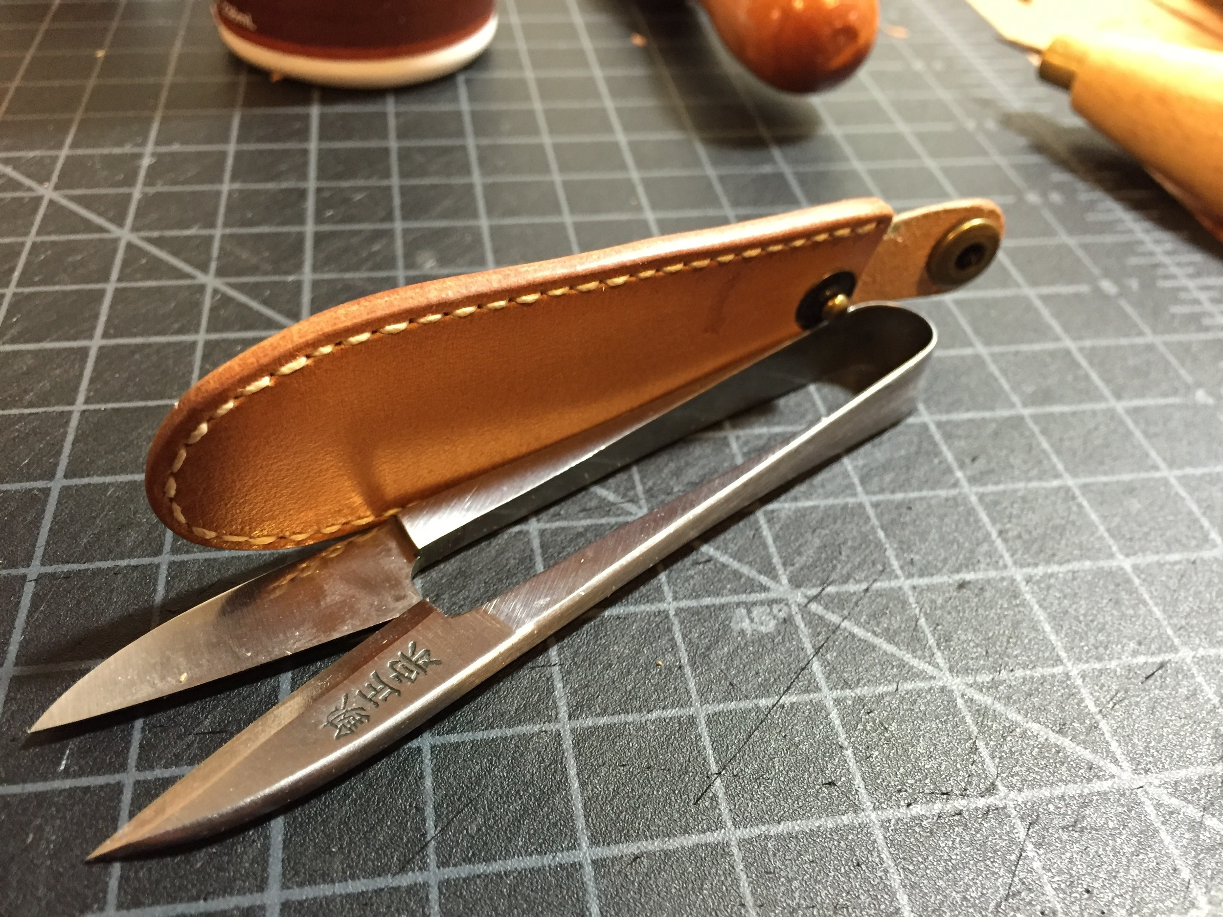 And here it is, burnished to a nice smooth edge. I use a couple of different burnishing methods, but for this one I dampened the edge with water and burnished with canvas, then rubbed in some beeswax until it became smooth with a bit of shine.
