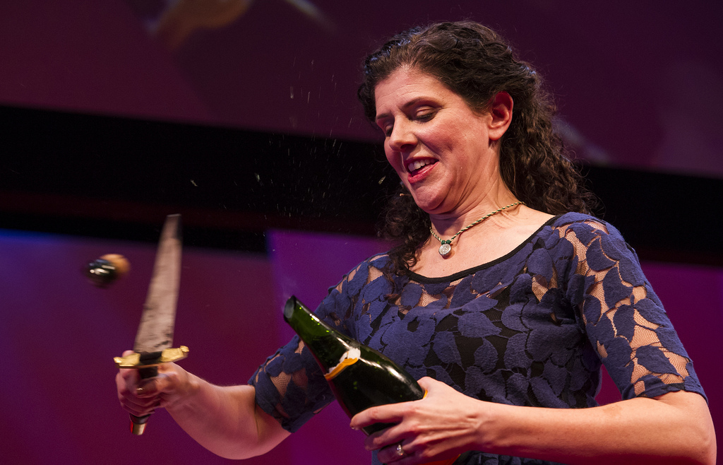 Sabering a champagne bottle at TED Global in 2012.