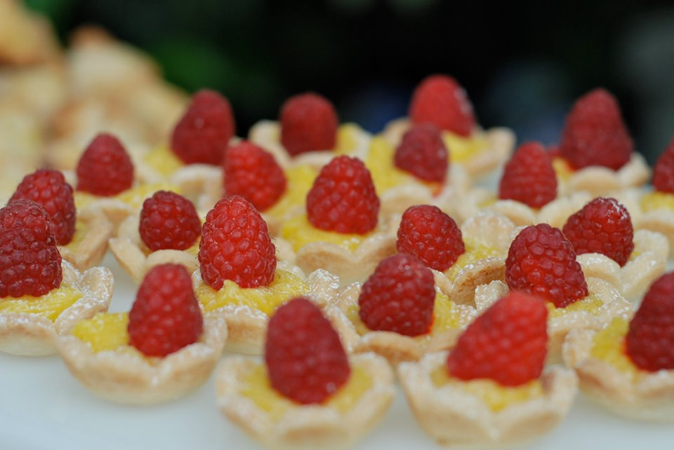 Lemon Tartlets garnished with fresh Oregon Rasperries