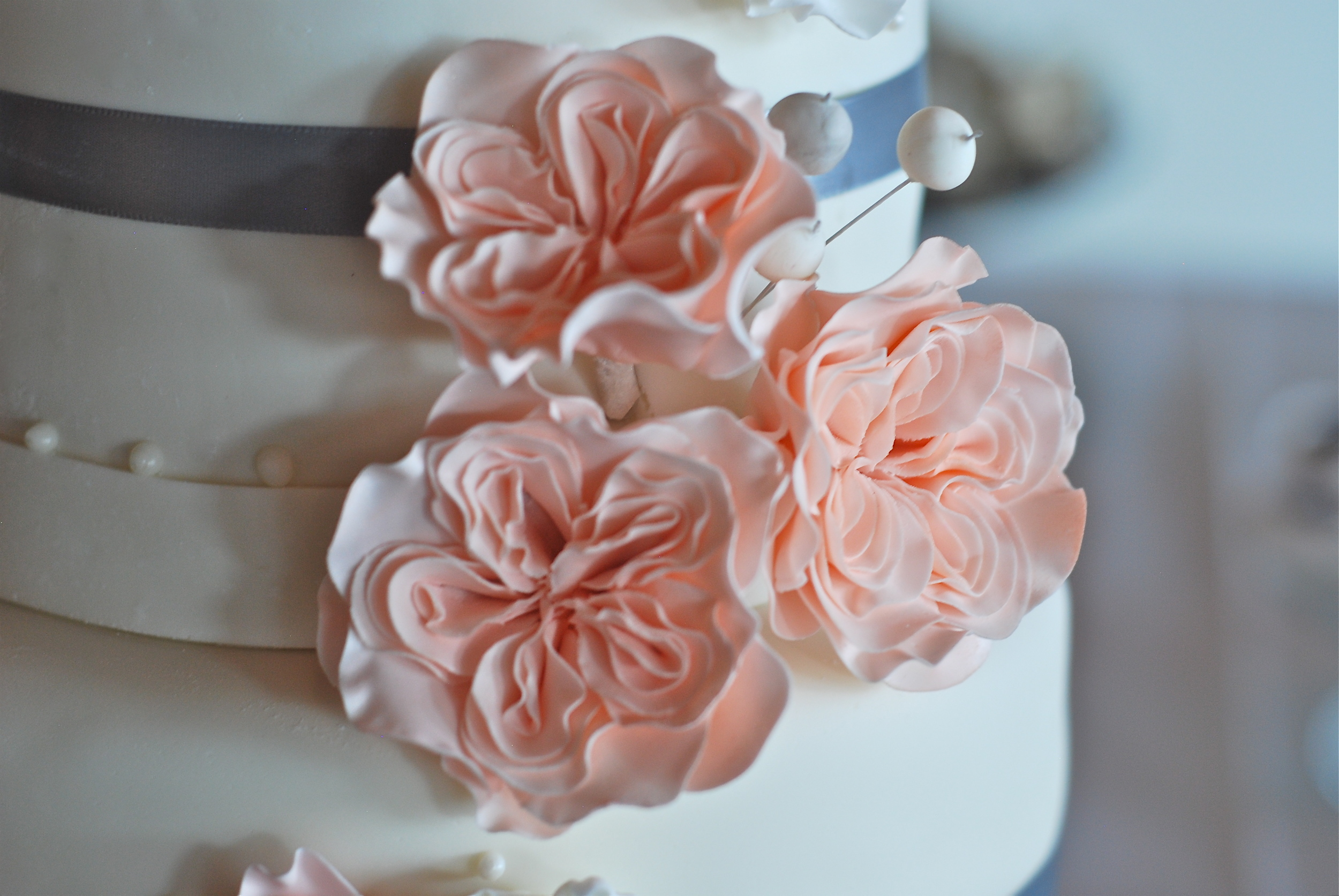 We love, love, LOVE the intricacy of these gumpaste cabbage roses!