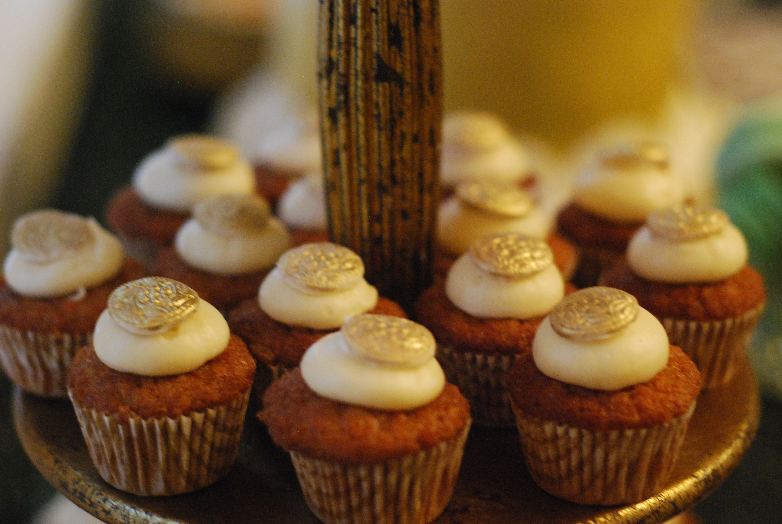 Carrot cake cupcakes with cream cheese frosting and sugar medallions
