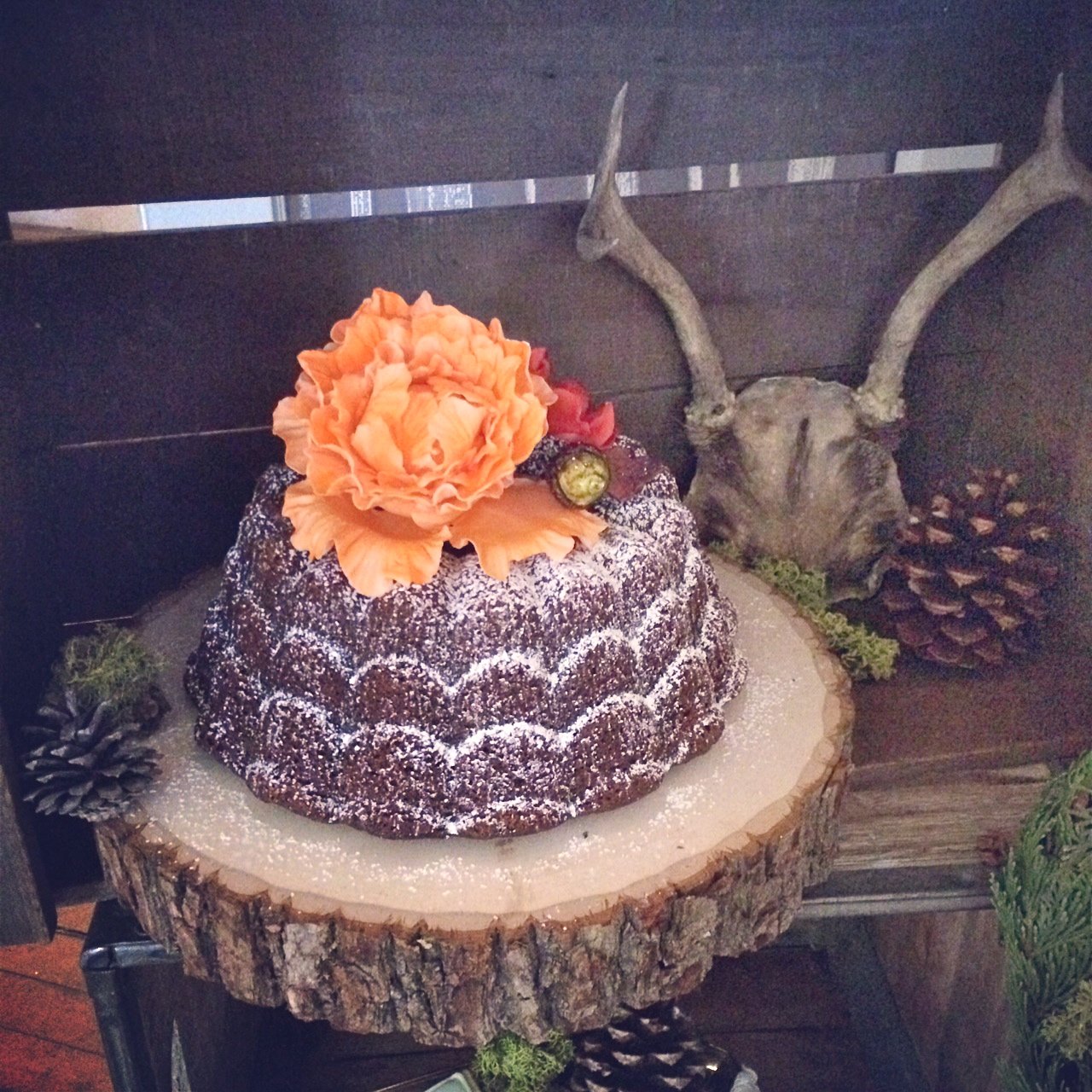 Rustic bundt cake complimented with autumnal sugar flowers