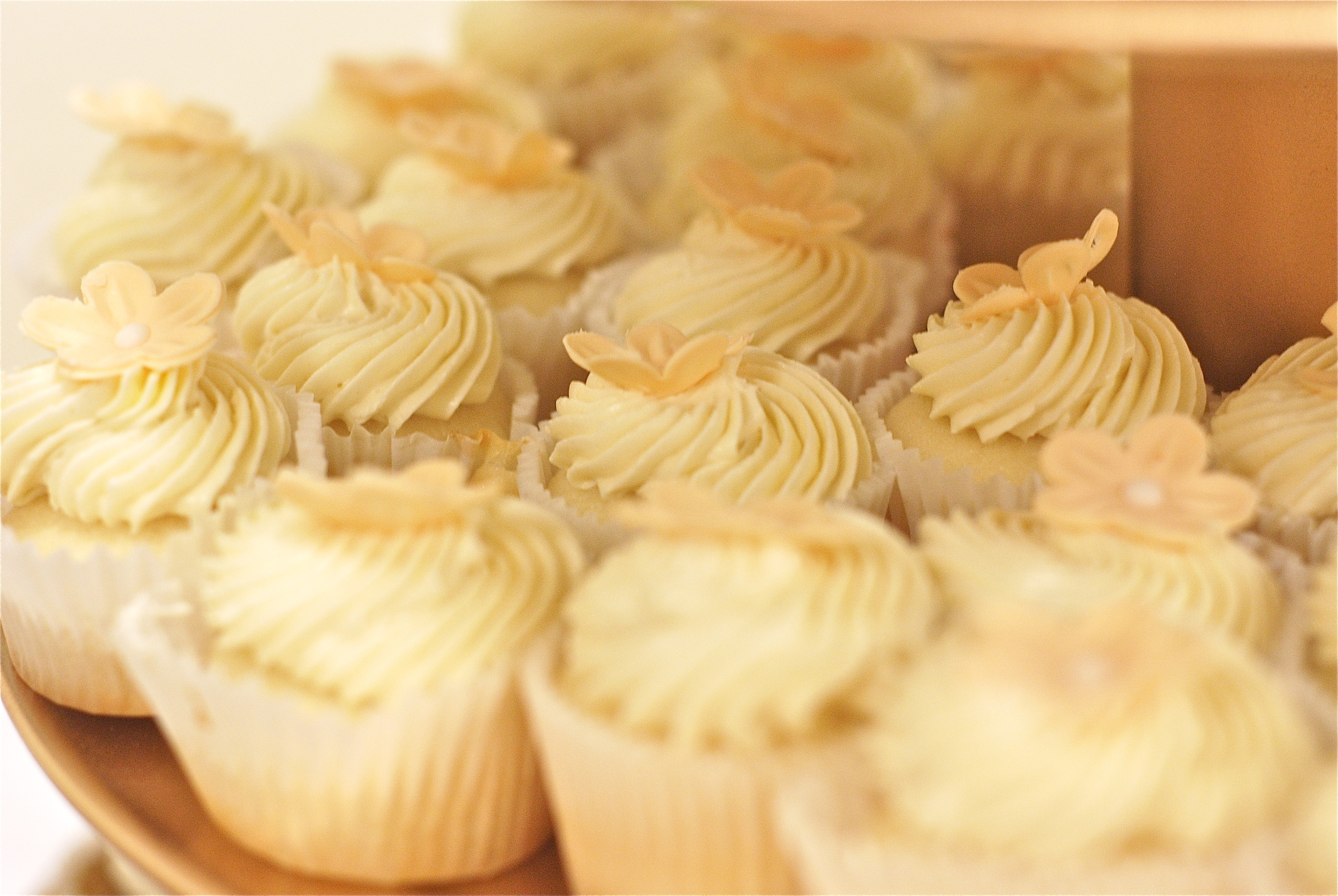 Lemon-filled classic white mini cupcakes