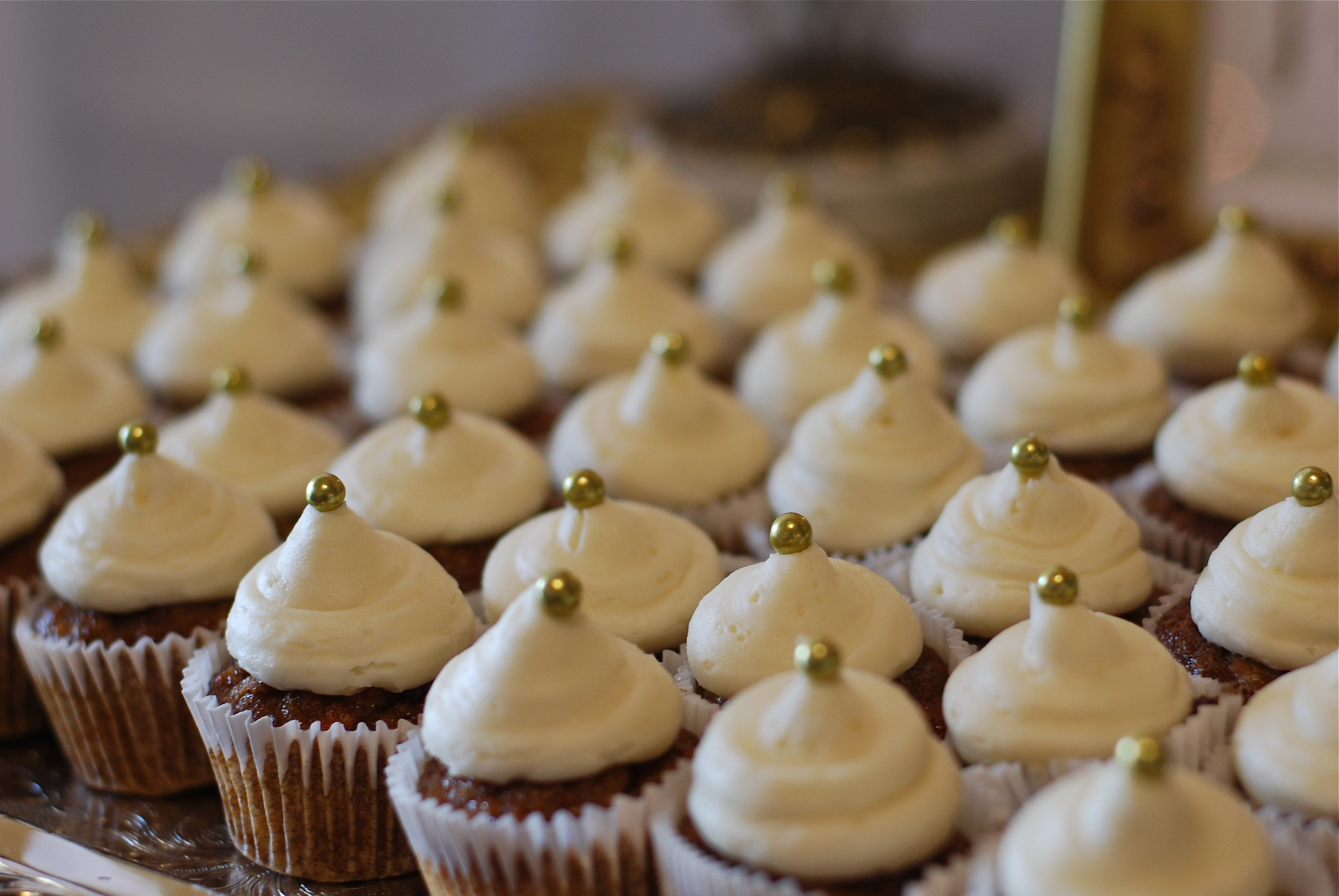 Carrot cake cupcakes with cream cheese frosting.  Who doesn't love to sample?!
