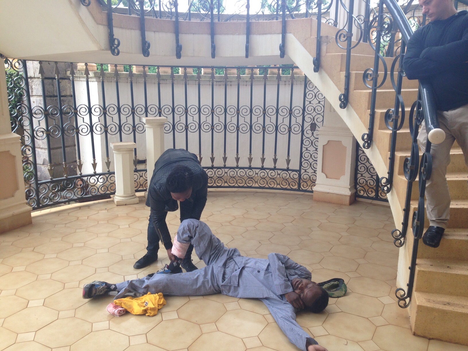 Shamiso putting a bullet victim in recovery pose. She did a great job!