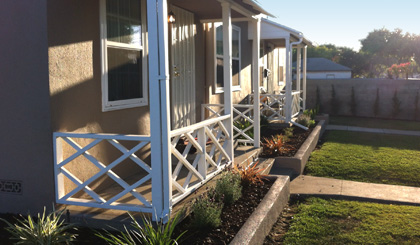 The Crenshaw duplex, home for four residents, receives a much- needed face lift and landscaping thanks to event participants.