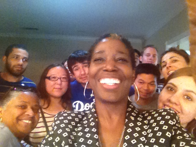 Roxanne Carter-Burnell (center) is surrounded by some of the members of the C2C (College to Career) family,