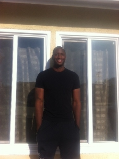 Curtis in front of his newhome.