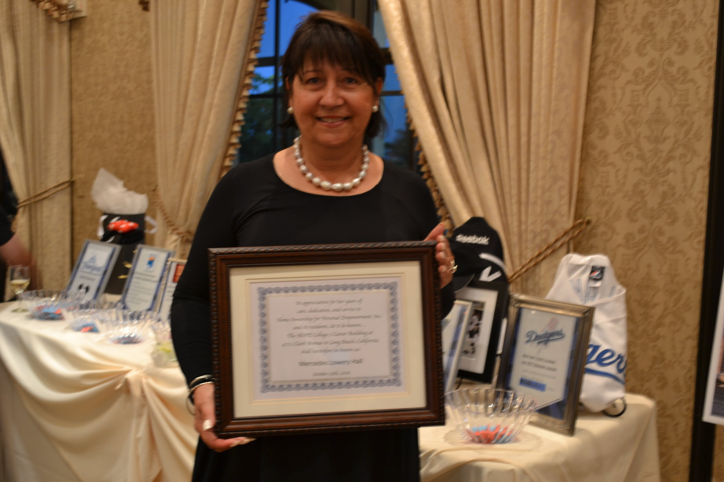 Mercedes Lowery honored at event.