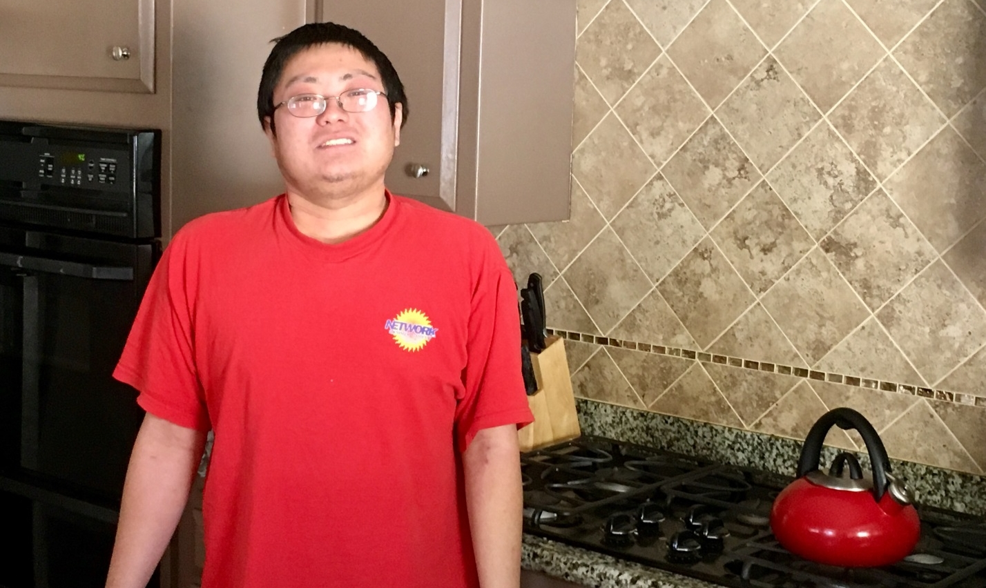 Justin standing in his HOPE home's kitchen in Norwalk. He has come out of his shell in recent years to improve self-confidence and socialization skills. (HOPE)