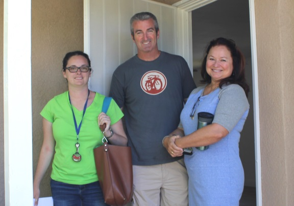 Emily smiles with parents as she prepares to move into her new HOPE home on Brink Ave.