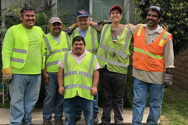 SVS team provides landscaping at a HOPE home. From left: Luis, Wilber, Donaciano, Ignacio, and Mario. Front: Gabriel. (SVS)