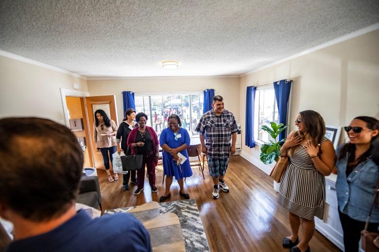 Center: new HOPE resident, Joe, entering apartment on Redondo Ave during grand opening celebration in 2019. (HOPE)
