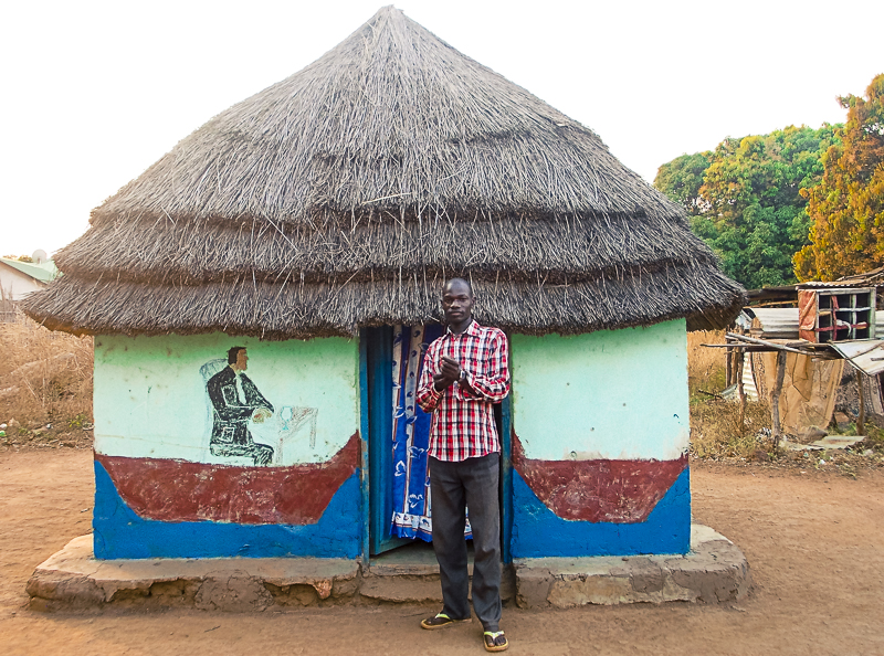 Makonis Billi in front of his house