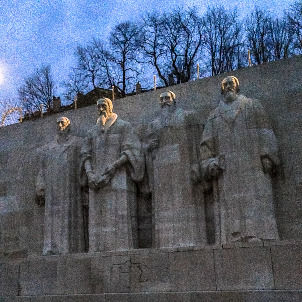 The Reformation Wall  in Geneva, Switzerland: Beza, Calvin, Farel, and Knox. Martin Luther is noted elsewhere along the wall. Photo by Kami Rice