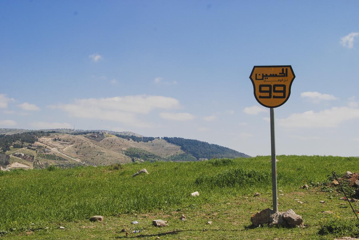 Road sign outside Jordan's Royal Botanic Garden: Hussein Highway 99, Tal Al-Rumman