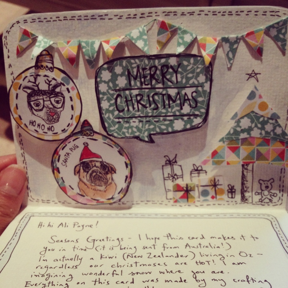 """Tiny Paper Bunting. """"Pop-out"""" decorations. Weird, sad-looking animals adorned with Christmas gear."""