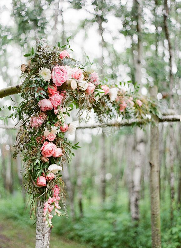 Large florals on a timber arbour.