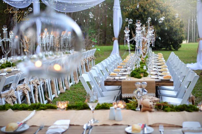 This Enchanted Chrystal Rainforest Wedding was styled and created by Sugar & Spice Events. I was lucky enough to work on this event and wow, it was absolute perfection! White Americano chairs, tables styled with hessian table runners, chrystal candelabras and moss, while over head the night sky was lit with fairy lights and hanging bulbs filled with tea light candles. Styled by Sugar & Spice Events.
