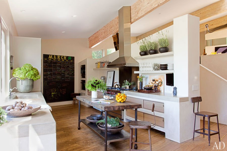 The kitchen features a concrete sink and countertops.