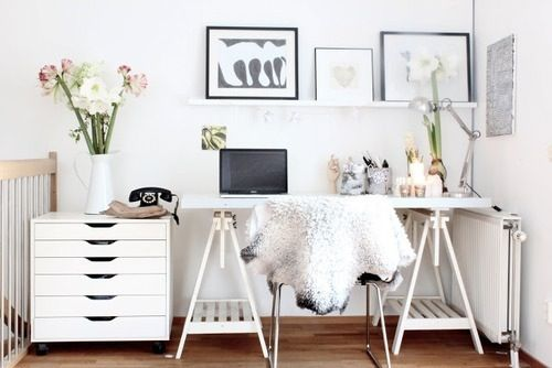 Tressle-leg desk, sheep skin over the chair, fresh blooms and some gorgeous art - I could sit in this space all day long!