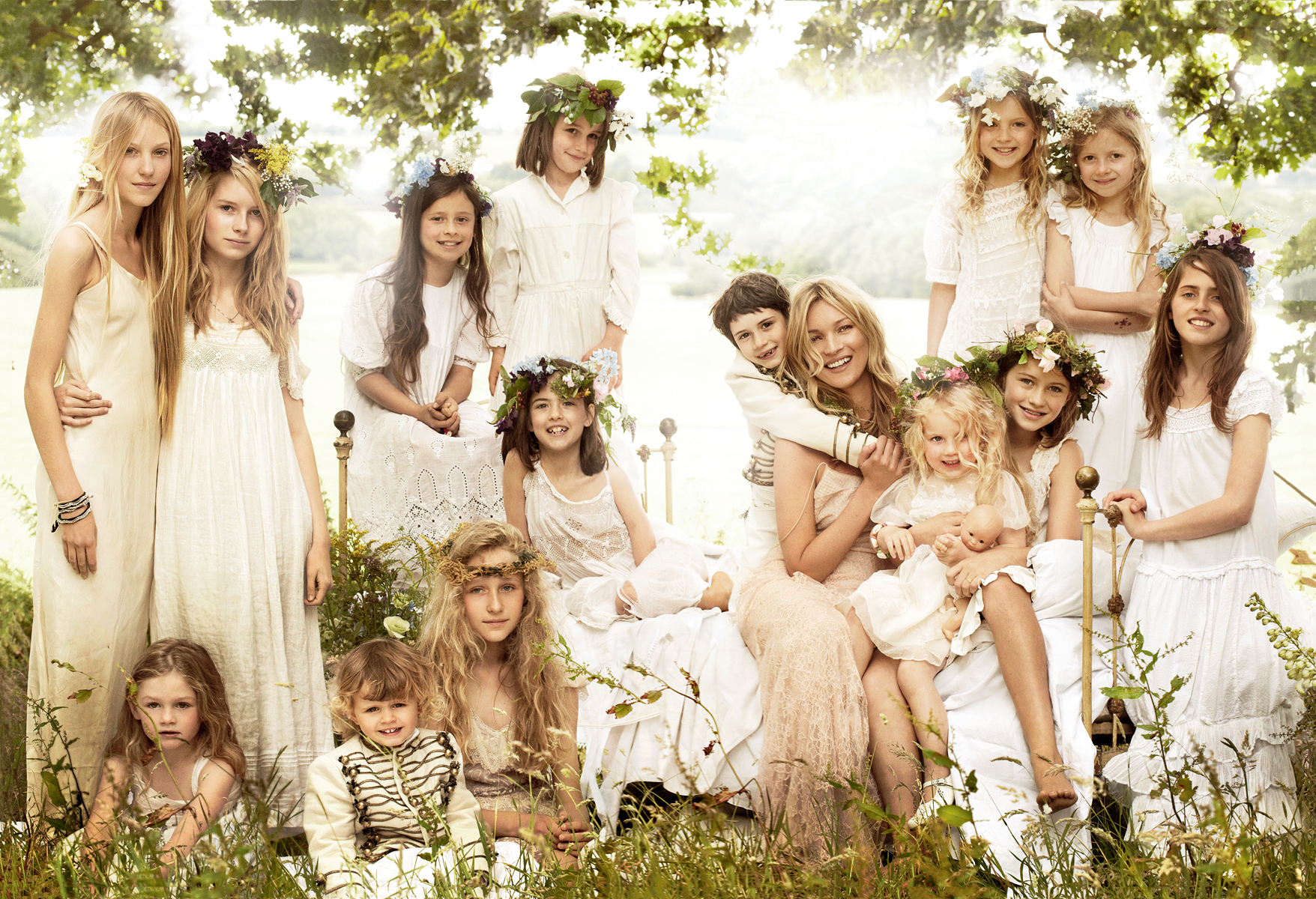 The most dreamy of wedding photos, an enchanted vision of Kate with her page boys and 14 flowers girls dress insilk and delicate eyelet petticoat dresses,