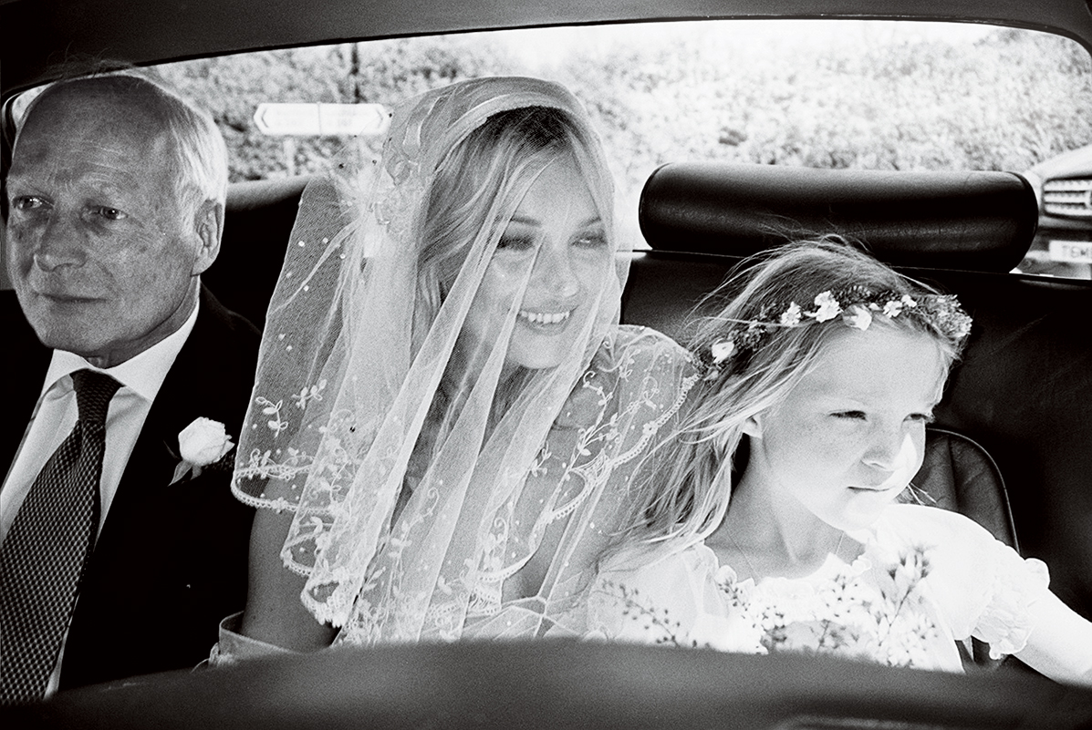 Father of the bride Peter Moss with Kate and her daughter, Lila Grace.