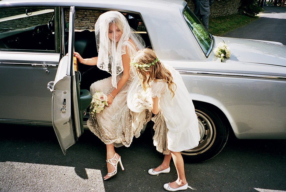 Lila Grace helping her mum, Kate Moss from the car.  She wore a pair of custom made maolo Blahnik shoes with a blue sole as her something blue.