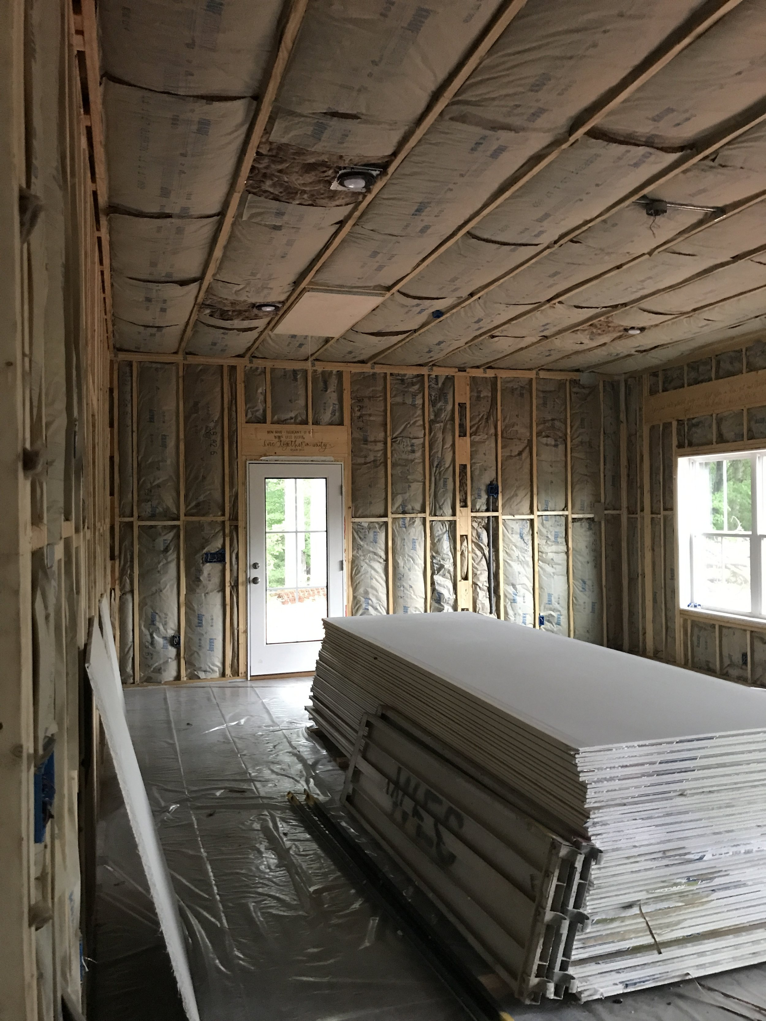 Between the insualtion and Sheetrock instalations