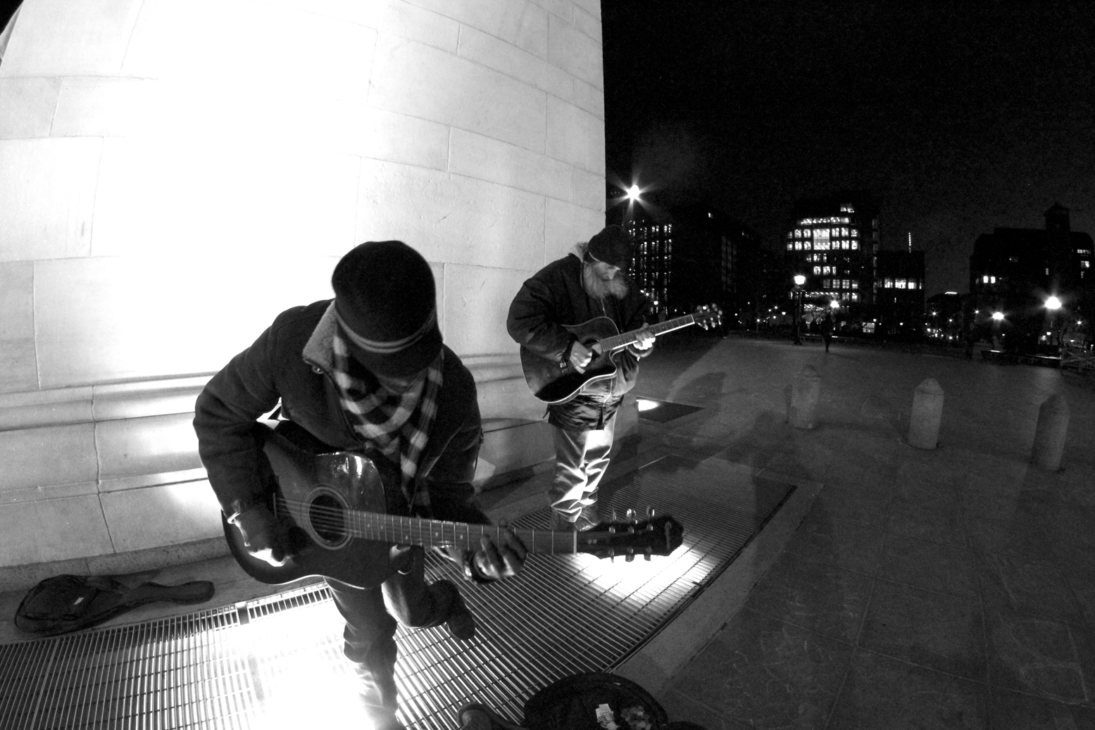 "Two men playing ""Sweet Child O' Mine"" , trying to earn a buck on a chilly Spring night.  I had to stand almost right in front of him to get this photo."