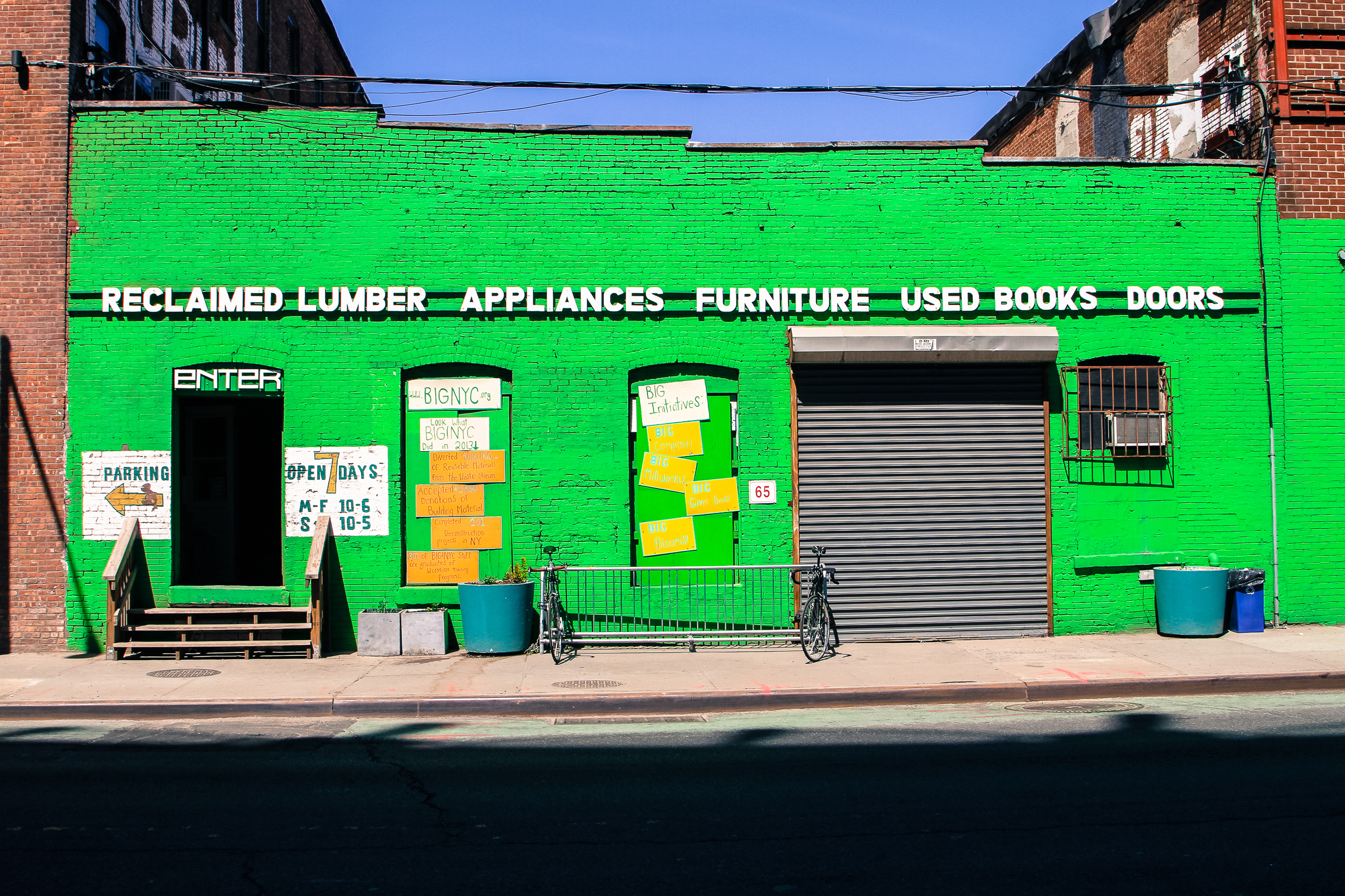 This bright green storefront definitely catches your attention on the street.  Also the fact that they sell used books along with reclaimed lumber.