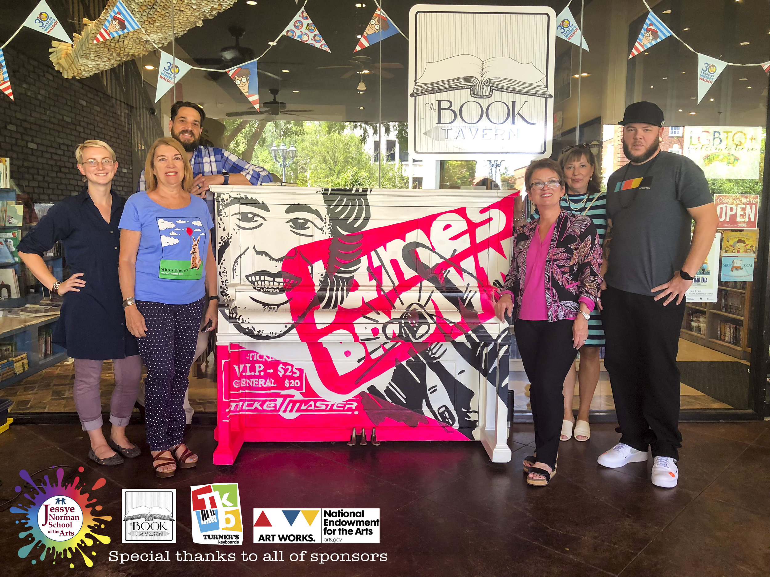 Pictured here:  artist Jason craig and some of our supporters of the Painted Piano Project  This painted piano is at the Book tavern location