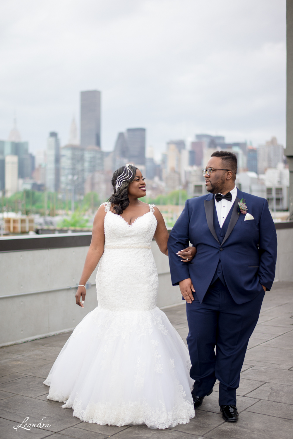 Bride and Groom on Rooftop of Ravel Hotel, Metropolitan building Wedding | Photography by Leandra